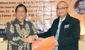 MoU between Faculty of Economics and Business Gadjah Mada University and DDTC