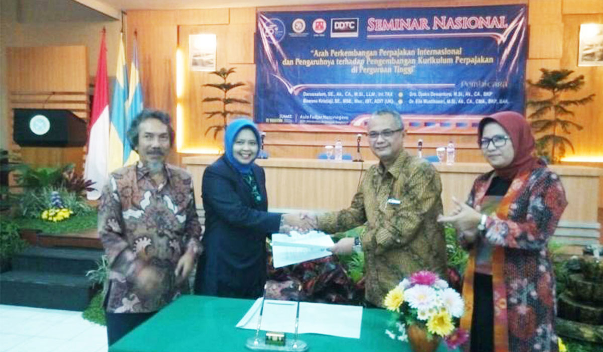 MoU between Faculty of Economy and Business Airlangga University and DDTC